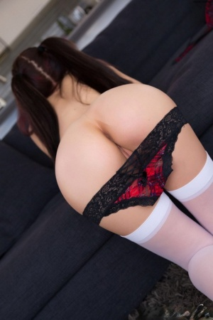 Dark haired amateur Katie Banks flaunts her round tits in pigtails & stockings
