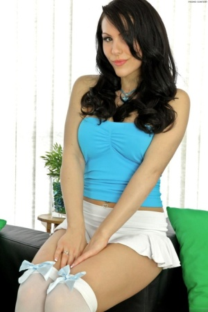 Brunette amateur Katie Banks unleashes her large tits in over the knee nylons