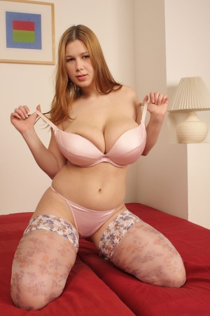 Big titted girl Terry Nova dildos her landing strip pussy in sexy stockings