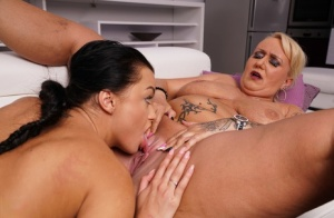 Mature blonde with tattoos and a young brunette hookup for lesbian sex