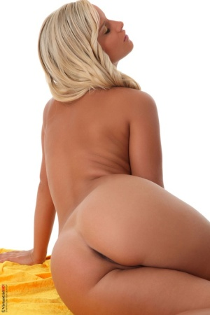 Blonde chick Miela works clear of a yellow dress to model naked in heels