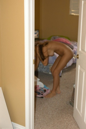 First timer Andie gets caught in the nude while doing her usual things at home