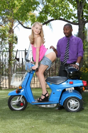 Young sexy Hannah Hays gets on her knees outdoors to suck a big black cock