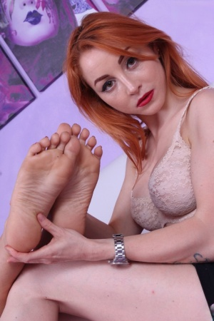 Lesbian girls Melyna and Petra show off their pretty feet in the underwear