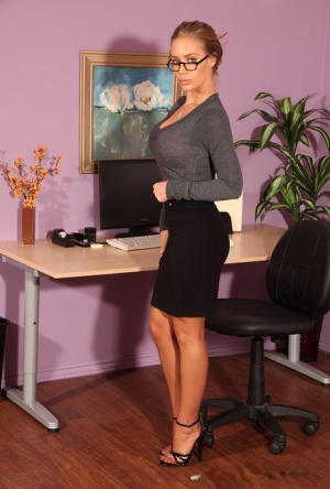 Blonde secretary strokes her shaved pussy in FF nylons atop her desk