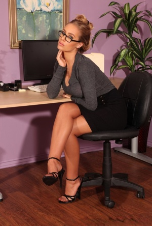 Blonde secretary pets her pussy in FF nylons paired with a garter belt