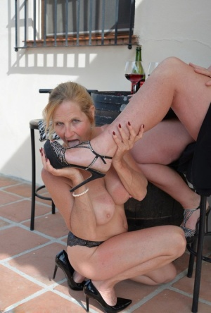 Mature woman Melody has boobs and legs licked by her lesbian lover on a patio