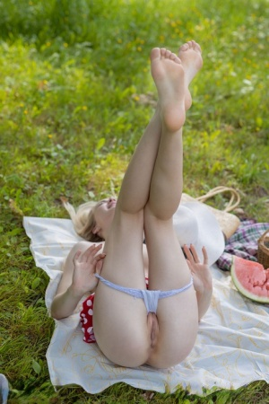 Cute teen Sophie gets totally naked while eating a watermelon in a meadow