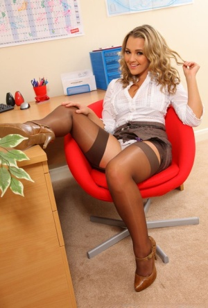 Blonde secretary Jodie Gasson unleashes her beautiful tits wearing nylons