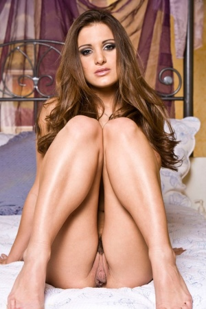 Solo girl Andie Valentino slip off pink lingerie for a centerfold spread