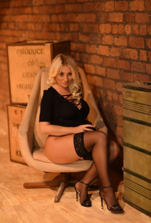 UK glamour model Stacey Robyn shows her big tits and ass in sheer stockings