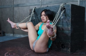 Asian girl Milcah Halili is restrained by a dyke during lesbian BDSM play