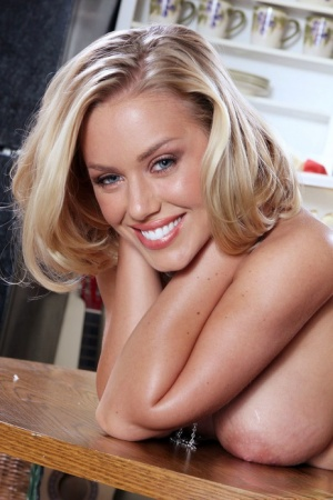 Hot MILF Nicole Aniston takes off her bikini on top of the kitchen table