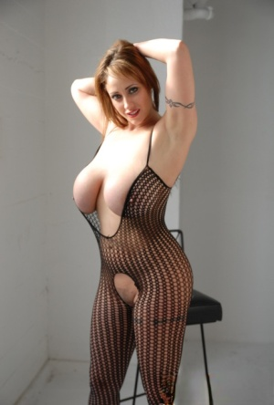 Sexy redhead Eva Notty shows off her big boobs and twat in a sexy bodystocking