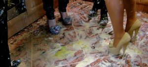 Drunk females douse themselves in flour while fully clothed at a party