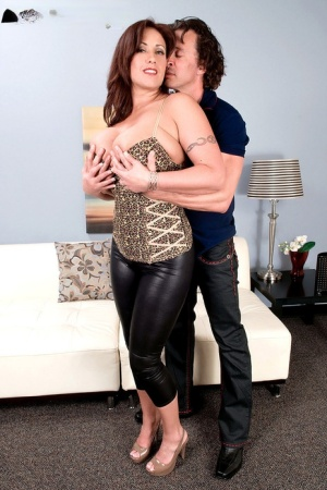 Seriously busty Eva Notty seduces younger guy with her giant big boobs