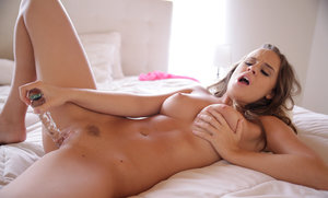 Erotic model Alexis Adams naked & toying with glass dildo for hot closeup view