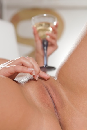 Young blonde girl Marry Queen pets her shaved pussy over a glass of white wine