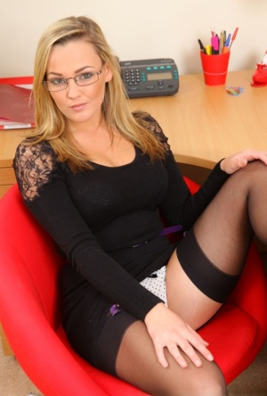 Blonde secretary Jodie Gasson strips to underwear and nylons at work