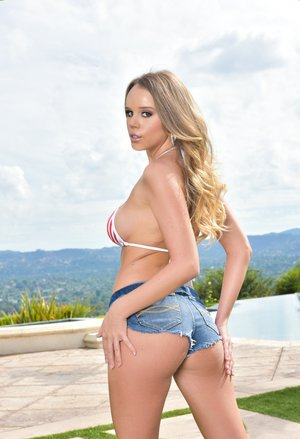 Solo model Alexis Adams peels off bikini to and jean shorts to pose naked