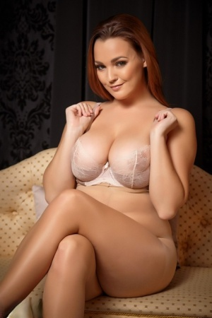 Chubby solo girl Jodie Gasson uncovers her big boobs as she removes her dress