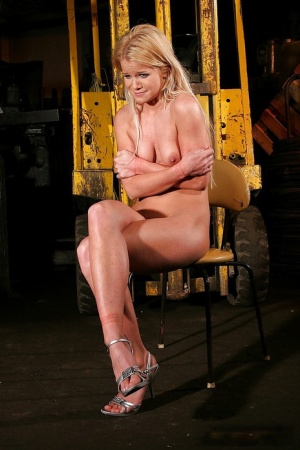 Mandy Bright humiliates her tied up girl and tears her with a dildo