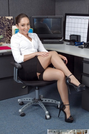 Cute office worker Remy LaCroix gets naked at work and fingers shaved cunt