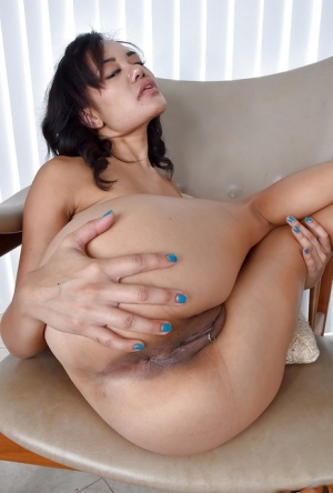 Asian babe Annie Cruz sliding yoga pants over MILF ass to bare trimmed twat