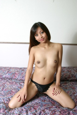Asian first timer Elle slipping odd black lace panties to pose nude