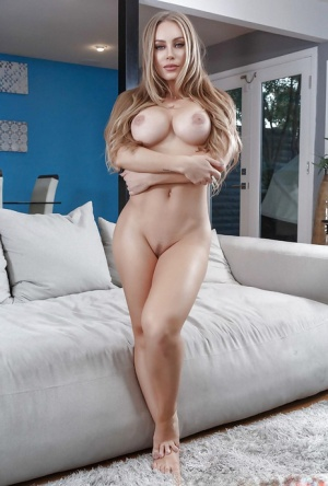 Busty blonde in fishnet stockings Nicole Aniston amazes with her shaved pussy