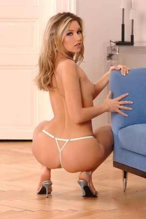 Hot blonde chick Cherry Jul slides shorts and thong over her tight ass