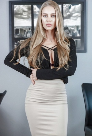 Office babe Nicole Aniston strips off skirt and lingerie to model bare naked