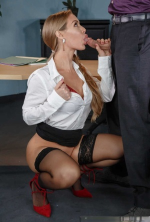Beautiful secretary Nicole Aniston seduces her boss and gives him oral sex
