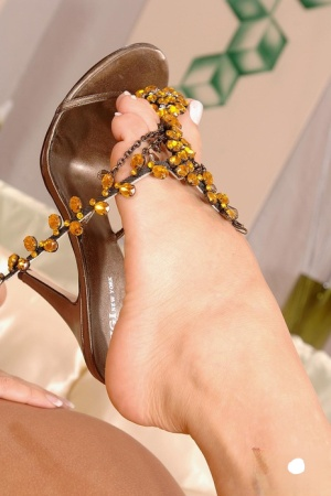 Hot MILF Cherry Jul shows some bare leg before releasing her feet from heels