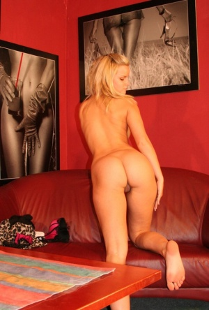 Blonde MILF with amazing body curves takes off her clothes in the office