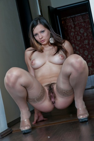 Busty babe in nylon stockings Bianka stripping and spreading her legs