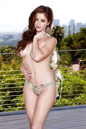 Gorgeous pornstar Emily Addison stripping and toying her cunt outdoor