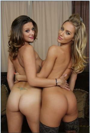 Big busted babes in stockings posing and stripping together