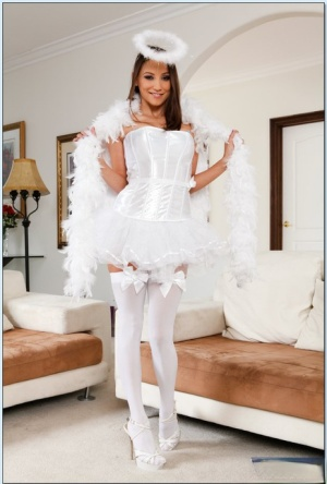 Sexy babe in stockings Celeste Star slipping off her angel outfit