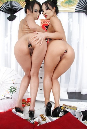 Asian vixens Annie Cruz & Asa Akira stripping and playing with butt plugs