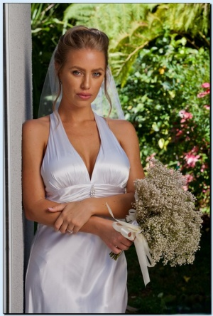 Stupendous bride in stockings gets rid of her dress and lingerie